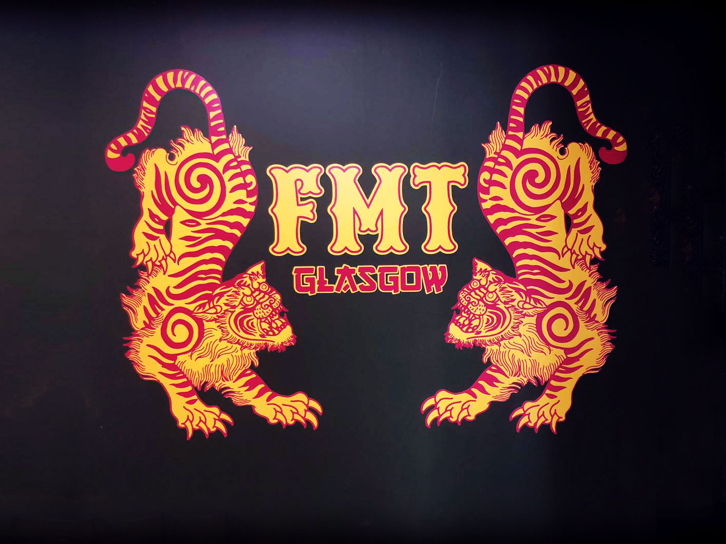 Image of wall decal / graphic of two symmetrical tattoo style tigers and FTM Tattoo inbetween them