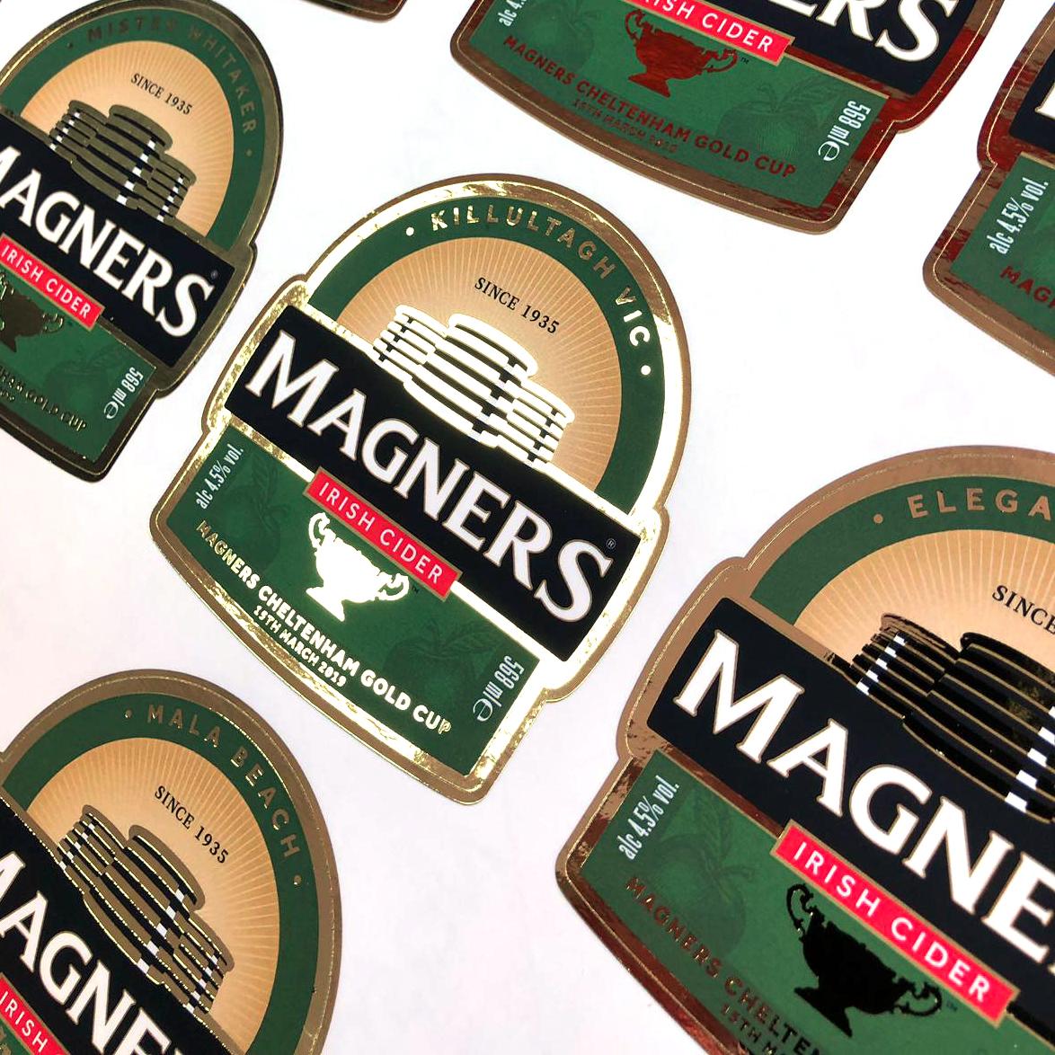 A sheet of custom cut, foil labels for Magners Cider bottles