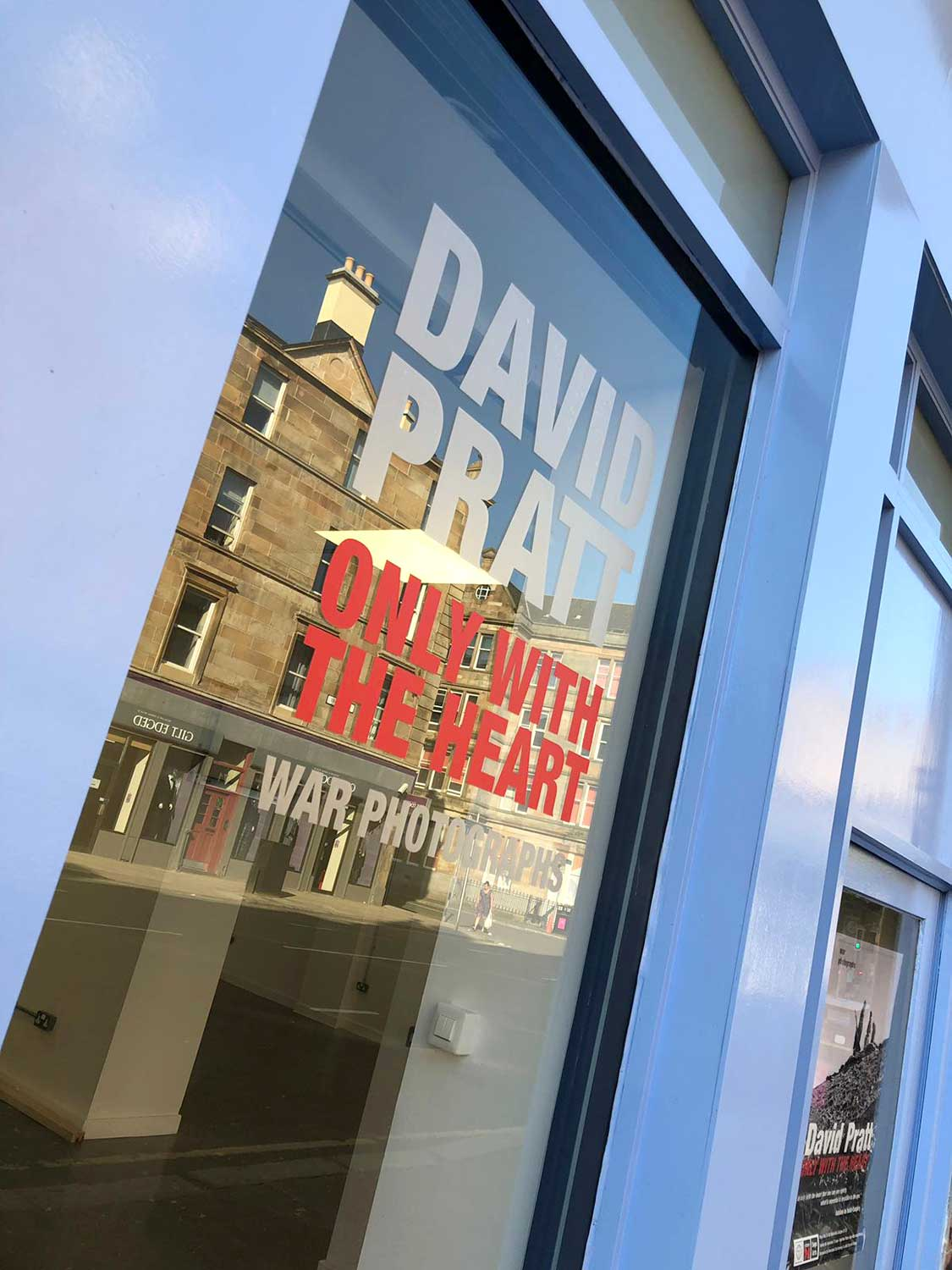 Image of printed and cut vinyl fitted to a glass window in a shop door.