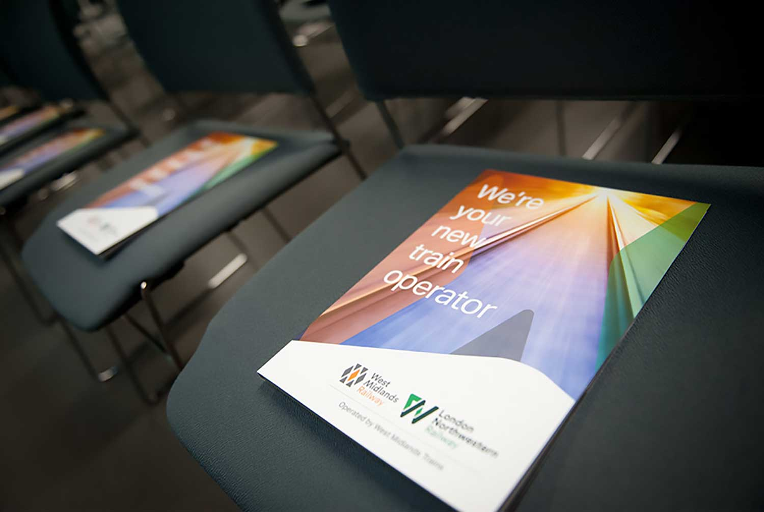 Image of brochures sitting on conference chairs